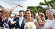 confetti with bride and groom in the spanish garden at kensington roof gardens