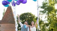 bride and groom release balloons on their wedding day