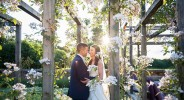 bride and groom at sunset in the rose garden at coworth park