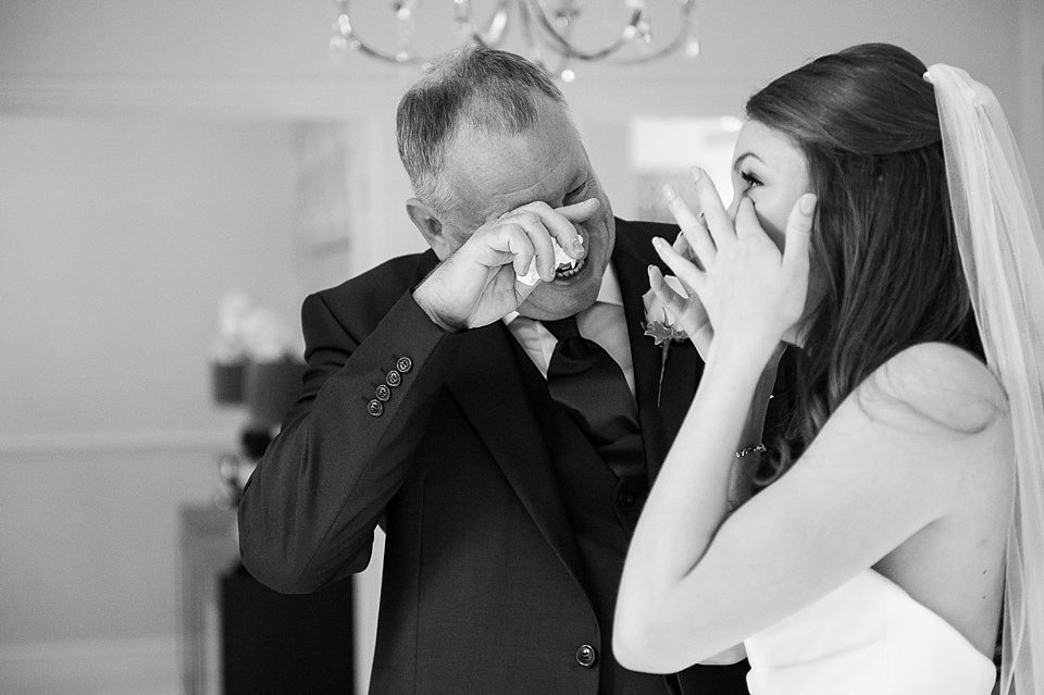 father of bride and bride have emotional moment_0004