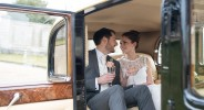 103 peeking-inside-vintage-car-at-Claire-Pettibone-bride-and-groom-drinking-champagne-spring-wedding-at-Woburn-Abbey-elegant-Bedfordshire-wedding-photographer-©-Fiona-Kelly-Photography